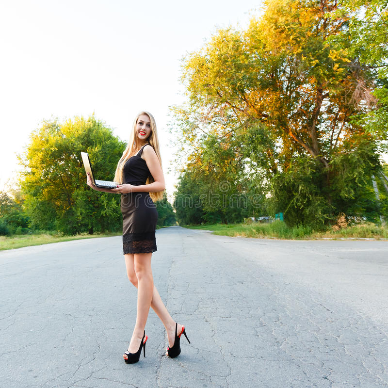 Young beautiful slender woman with a laptop stock photos