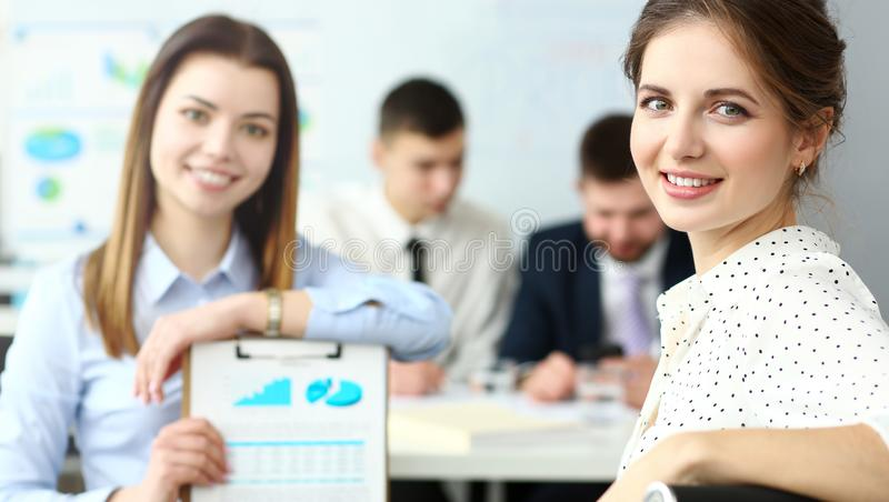 Young beautiful smiling clerk in office looking in camera stock photography