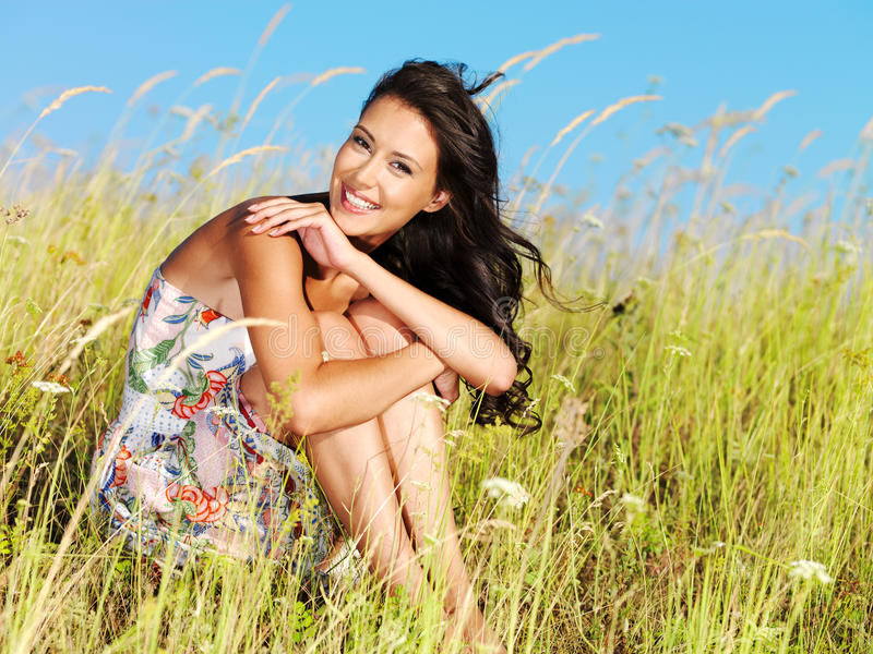 Young beautiful smiling woman outdoors royalty free stock photos