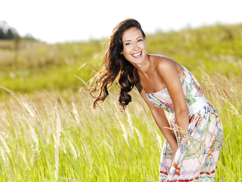 Download Young Beautiful Smiling Woman Outdoors Stock Photo - Image of brown, beautiful: 15413772