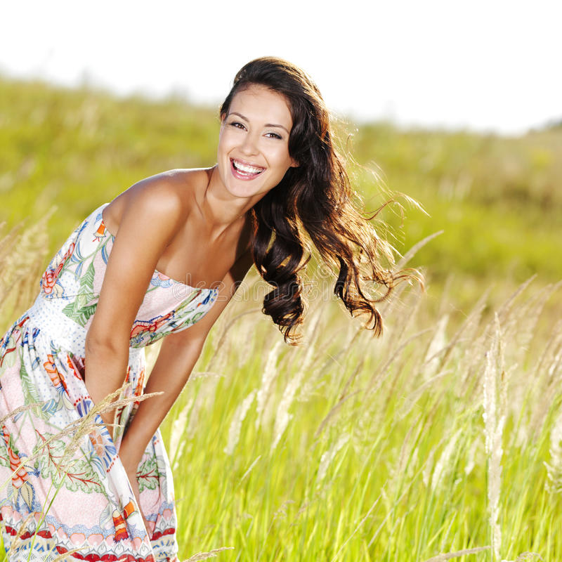 Young beautiful smiling woman outdoors stock images
