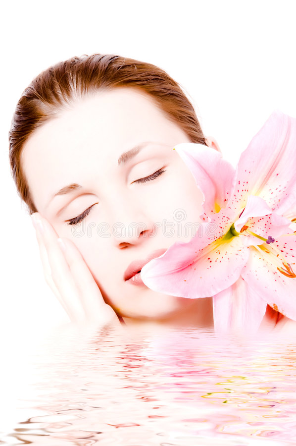 Young beautiful spa woman. With lilly stock photo