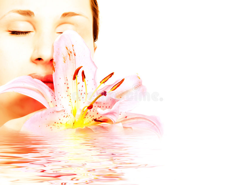 Young beautiful spa woman. With lilly stock image