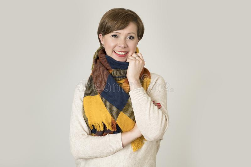 Young beautiful and stylish 30s red hair woman sweater and Autumn colorful scarf smiling happy stock photos