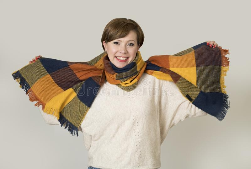 Young beautiful and stylish 30s red hair woman sweater and Autumn colorful scarf smiling happy royalty free stock photography