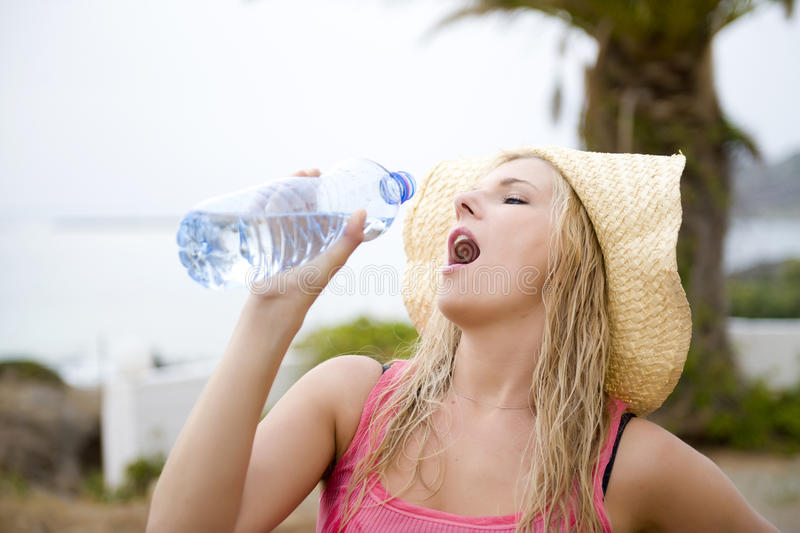Download Young Beautiful Summer Woman With Bottle Of Water Stock Photo - Image: 12897518