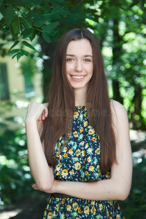 Young beautiful teen girl in summer park royalty free stock images