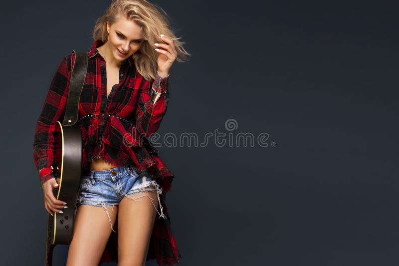 Young beautiful teenage girl playing on guitar. Concert. Hobby. royalty free stock photos