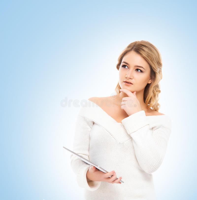Young and beautiful teenager girl holding a tablet royalty free stock photos