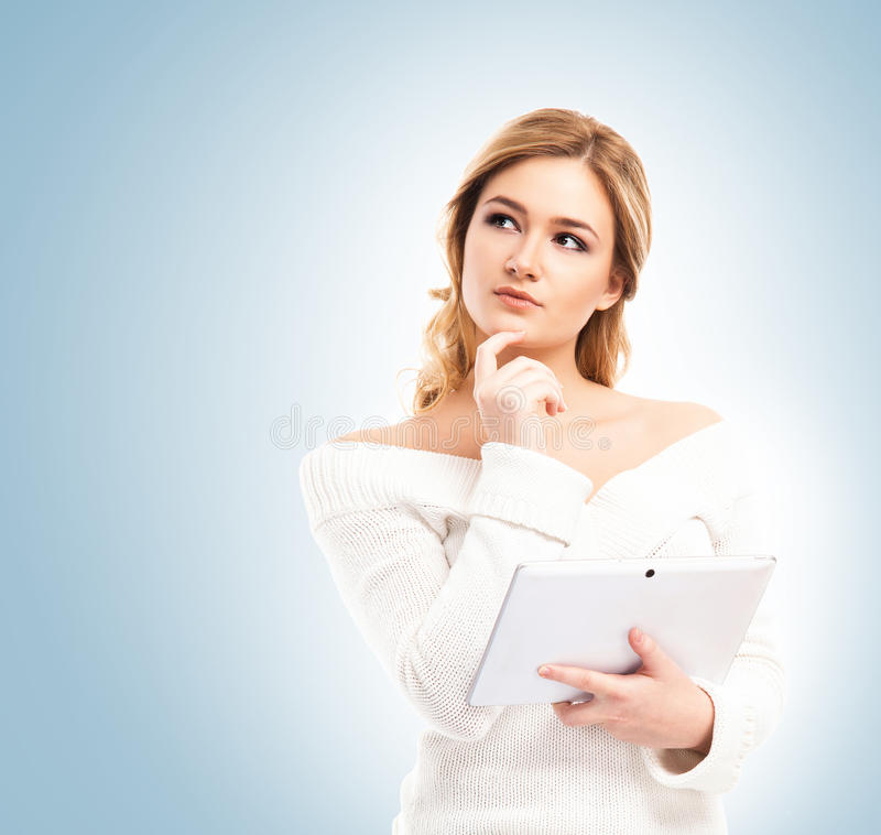 Young and beautiful teenager girl holding a tablet royalty free stock photography