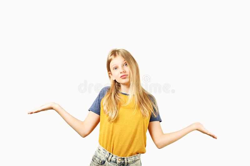 Young beautiful teenager model girl posing over white isolated background showing emotional facial expressions. royalty free stock images