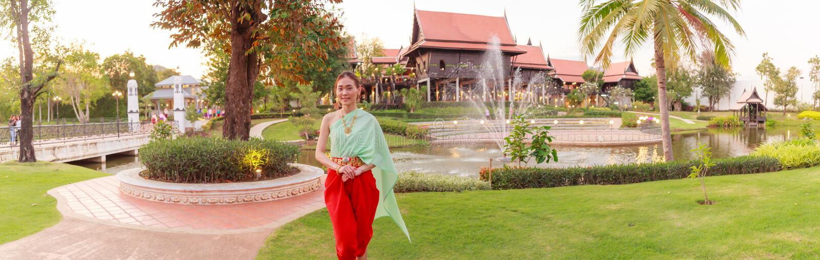 Young Beautiful Thai Asian woman dressing in vintage retro Traditional Thai costume in wait to welcome guest. Thailand Cultural royalty free stock image