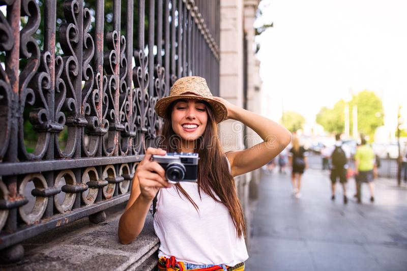 Young beautiful tourist woman using a photo camera royalty free stock image