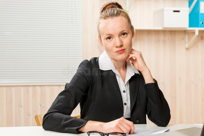 Young beautiful and very successful woman at work royalty free stock images