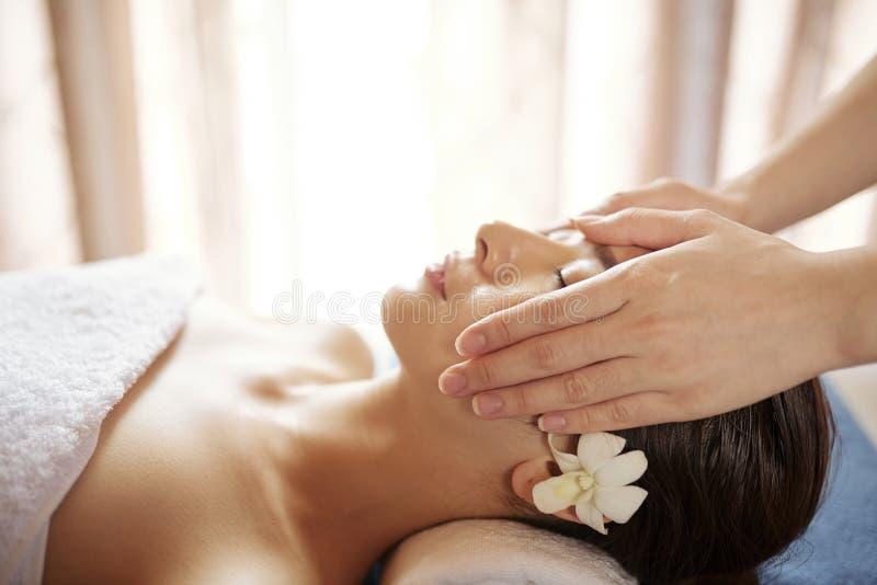 Rejuvenating face massage stock photos