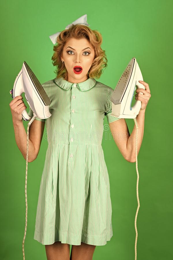 Young beautiful vintage housewife ironing royalty free stock photo