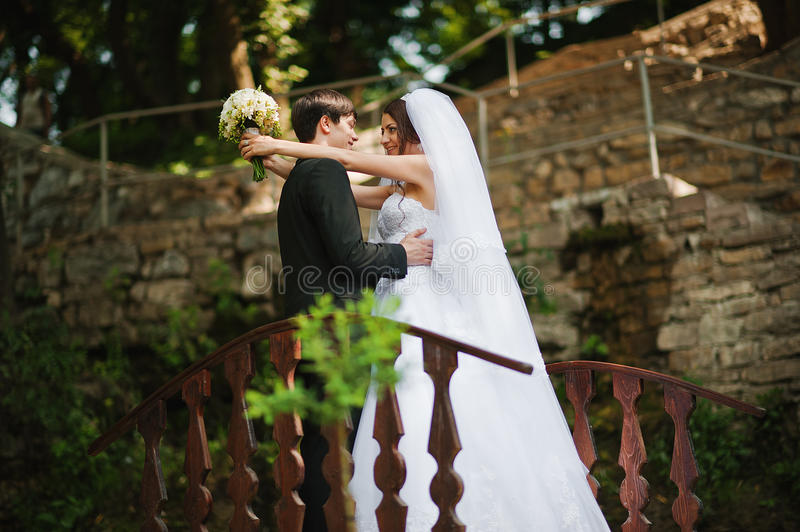 Young beautiful wedding couple. At the bridge stock photo