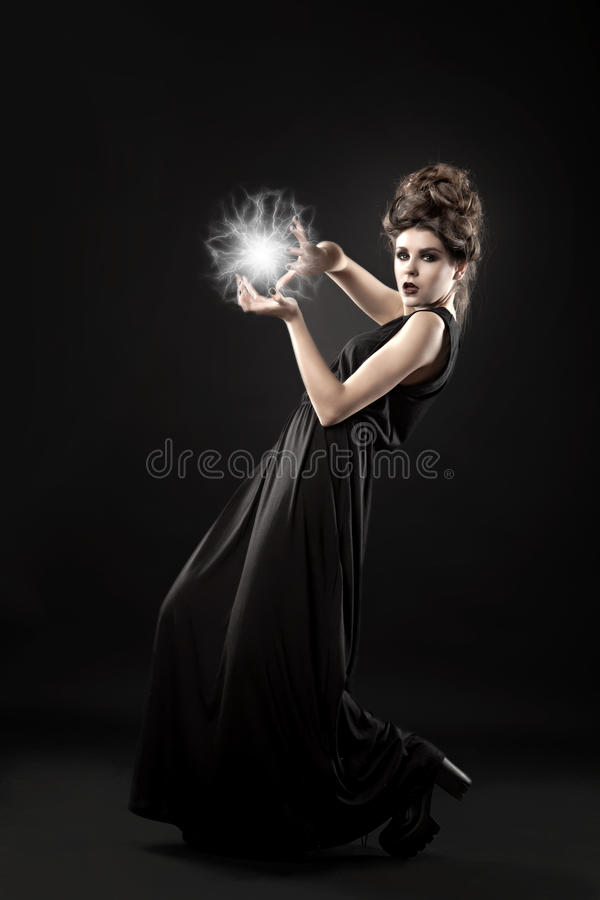 Young beautiful witch. Portrait of woman in the studio stock photos