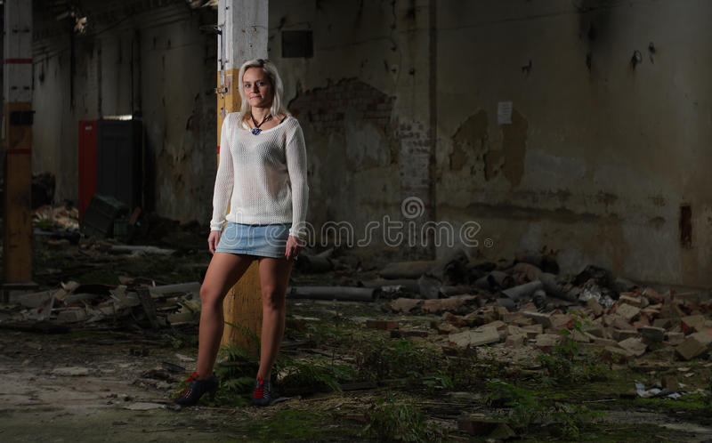 Young beautiful woman in an abandoned factory stock image