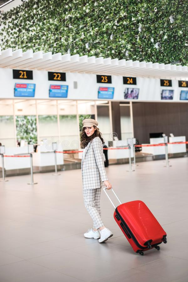 Young beautiful woman in Airport entrance hall. royalty free stock image