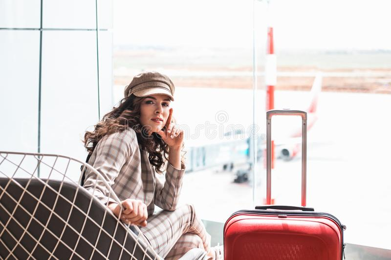 Young beautiful woman in Airport waiting room. royalty free stock image