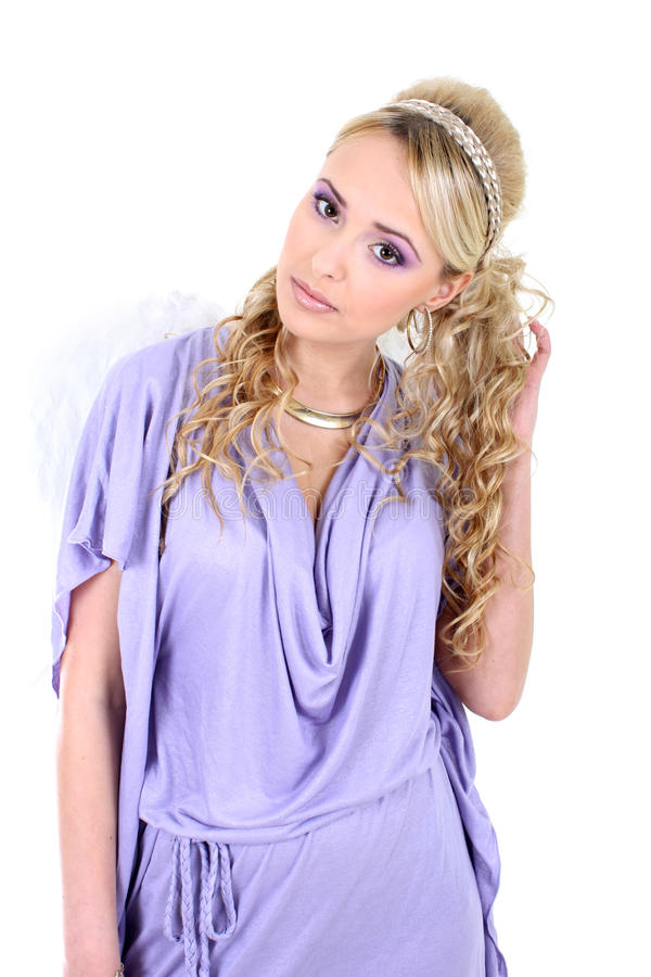 Young beautiful woman with angel wings. Young blonde in violet with angel wings stock photography