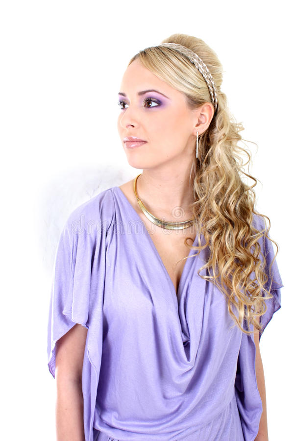 Young beautiful woman with angel wings. Young blonde in violet with curly hair and angel wings stock photography