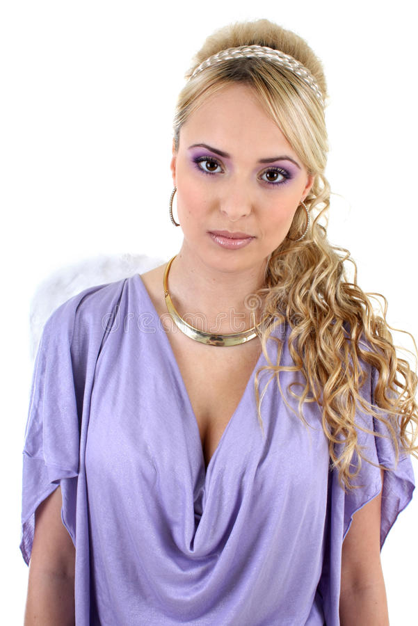 Young beautiful woman with angel wings. Young blonde in violet with curly hair and angel wings stock photo