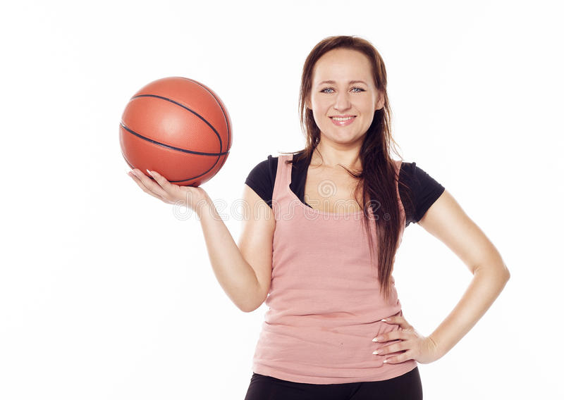 Young beautiful woman with a ball stock image