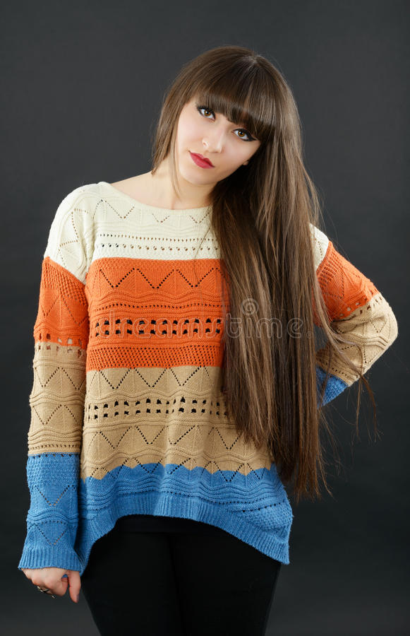 A Young Beautiful Woman With Bangs In Studio Royalty Free Stock Images