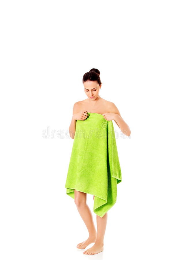Young beautiful woman after bath full portrait isolated over white. royalty free stock photo
