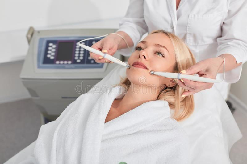 Young beautiful woman being done a face lift the natural way stock photo