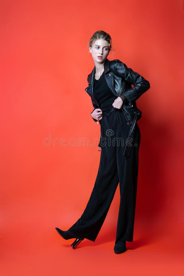 young beautiful woman in black clothes posing in the Studio. Attractive female model in stylish casual clothes stock photo