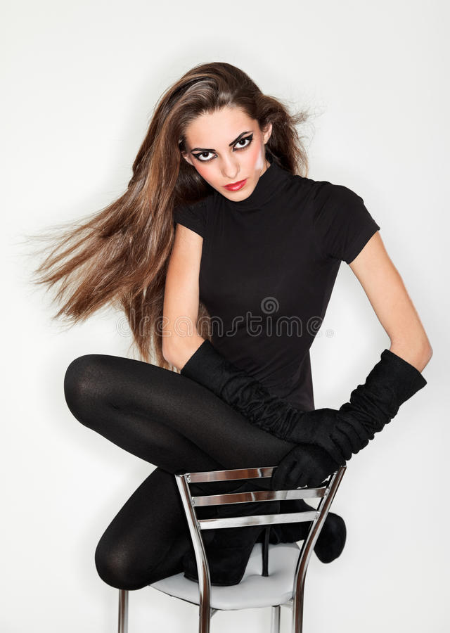 Young beautiful woman in black combi dress royalty free stock photo