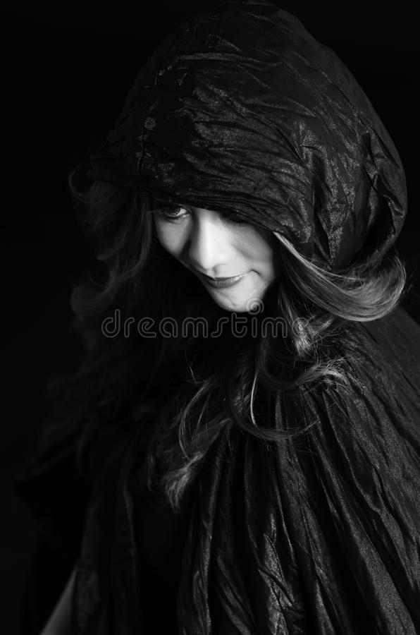 Young beautiful woman in the black dress stock image