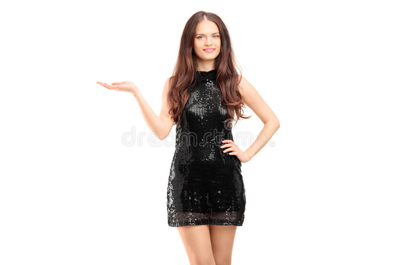Download Young Beautiful Woman In A Black Elegant Dress Gesturing Stock Image - Image: 32358843