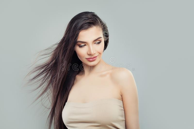 Young beautiful woman with blowing hair looking at background. With copy space stock photos