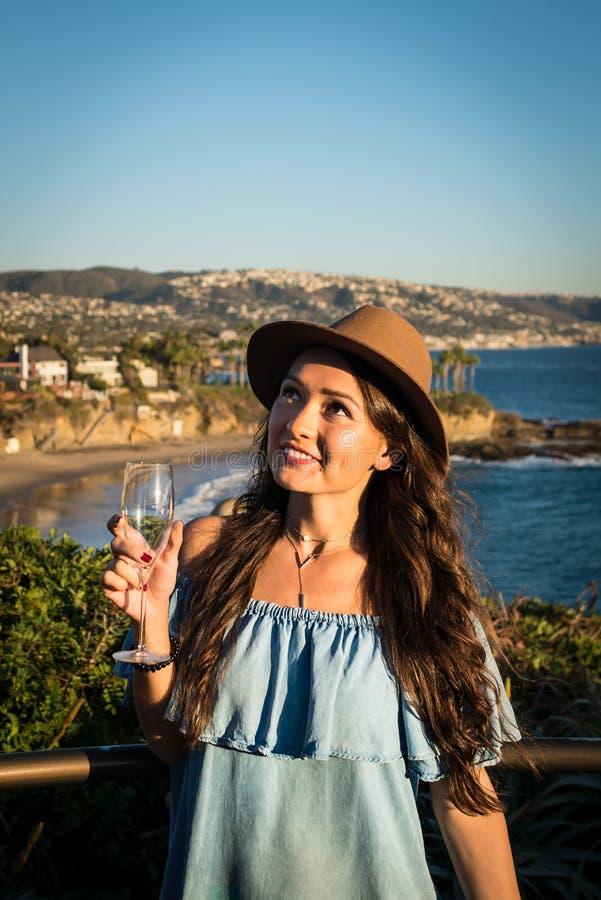 Young beautiful woman in blue dress stock photo