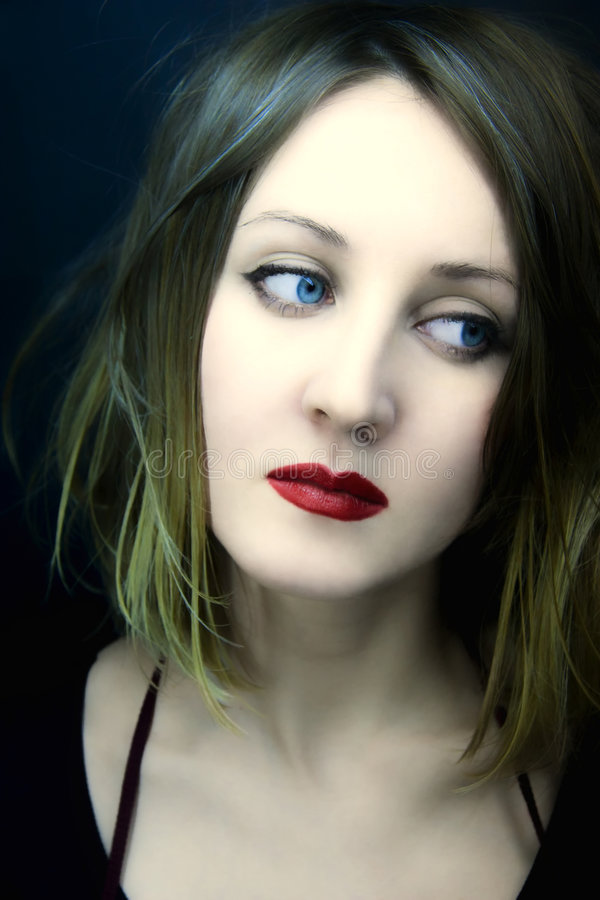 Young beautiful woman with blue eyes stock image