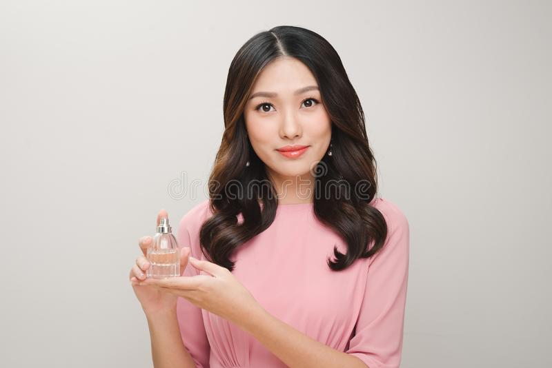 Young beautiful woman with bottle of perfume. Perfect Makeup. Fa stock photos