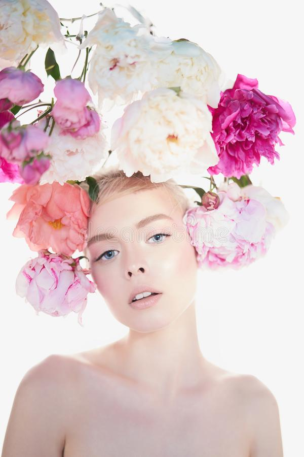 Young beautiful woman with bouquet of roses. Professional art makeup royalty free stock images