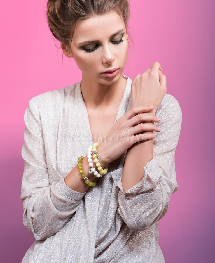 Young beautiful woman with bracelets of beads on hand royalty free stock images