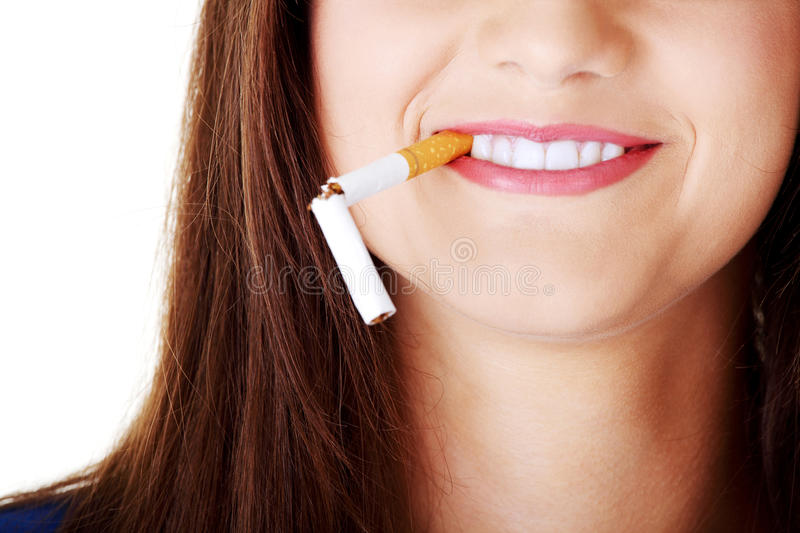 Young beautiful woman with broken cigarette. Stop smoking concept. Isolated on white royalty free stock images