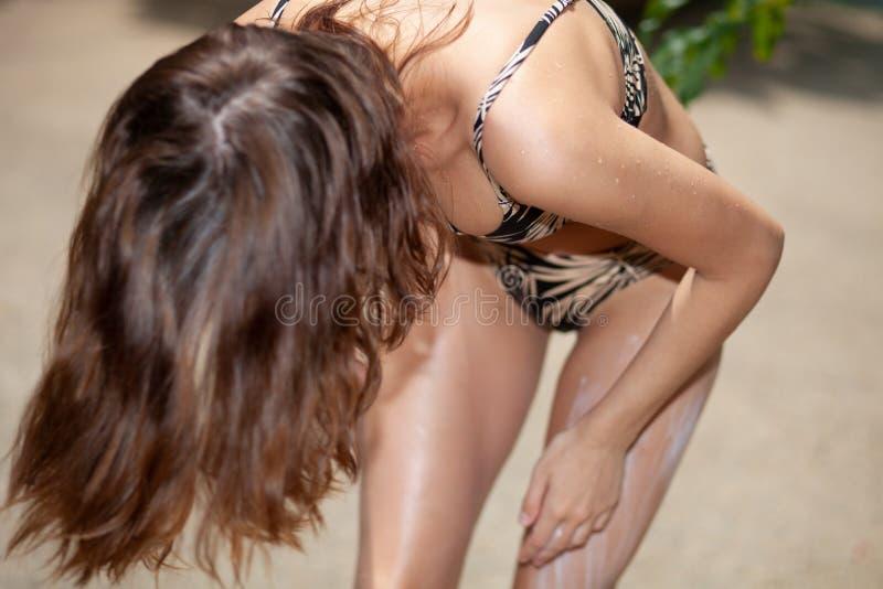 Young woman using sun cream stock image