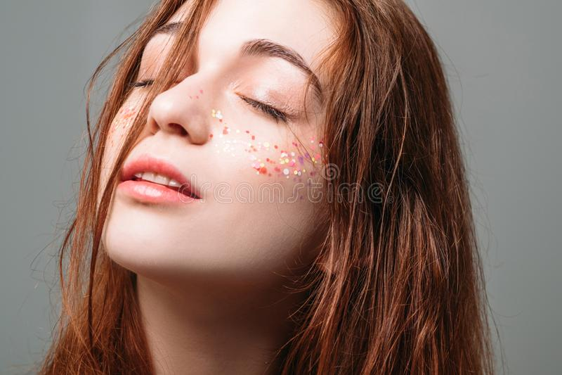 Young beautiful woman calm peace facial expression stock photos