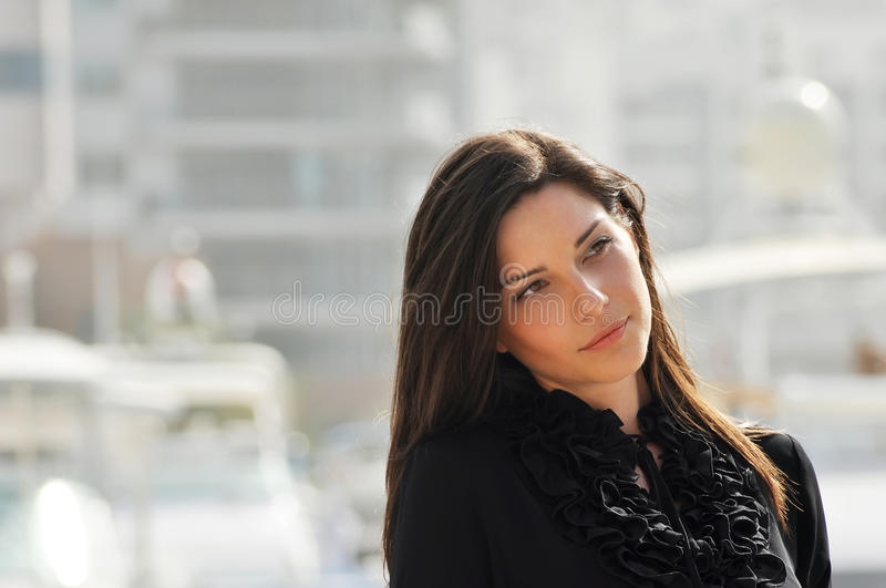 Young beautiful woman in the city royalty free stock image