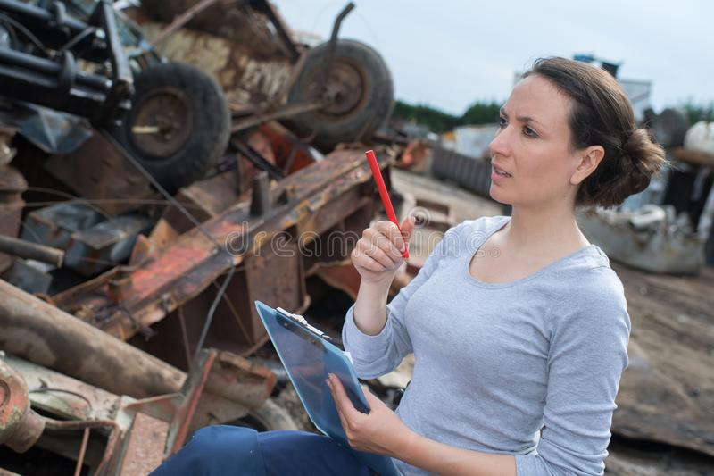Young beautiful woman with clipboard working at landfill stock images