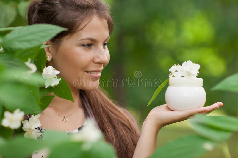 Young beautiful woman with cosmetic cream stock images