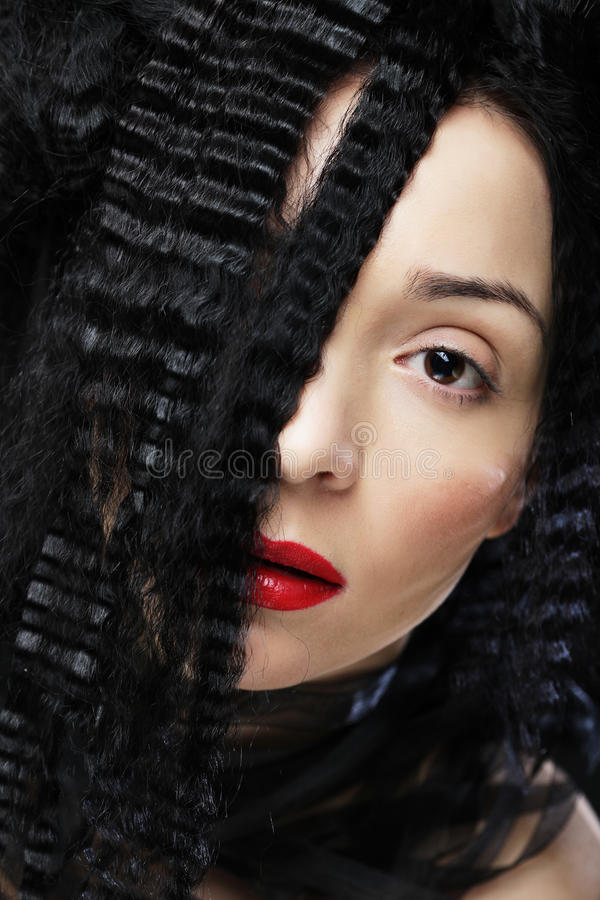 Young beautiful woman with curly hair and red lips. Glamour fashion portrait stock photos