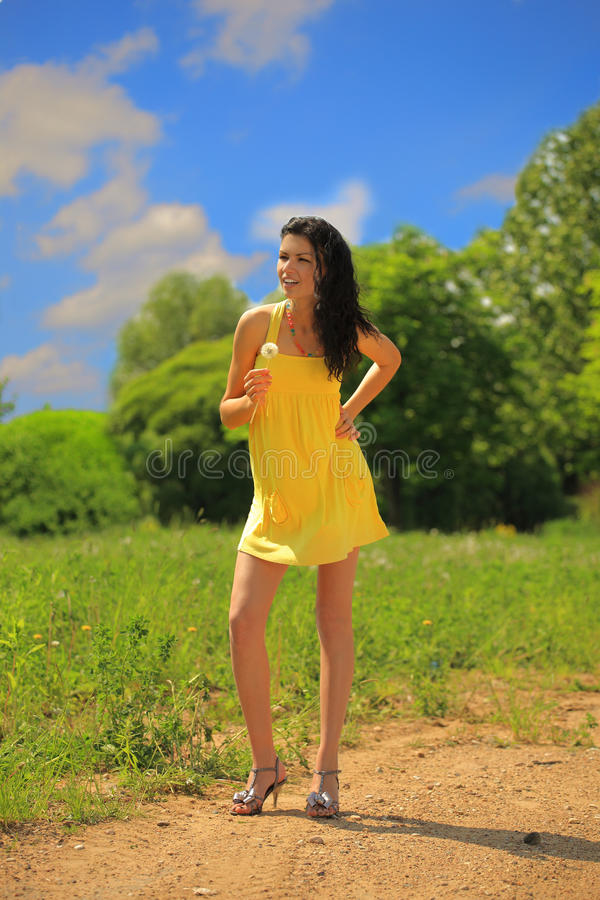 Download Young Beautiful  Woman With Dandelion Flower Outdo Stock Photo - Image: 21434210